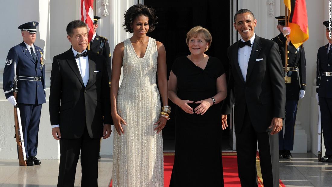 President Barack Obama and first lady Michelle Obama greet German Chancellor Angela Merkel and her husband Joachim Sauer at the White House on June 7, 2011, for their state dinner.