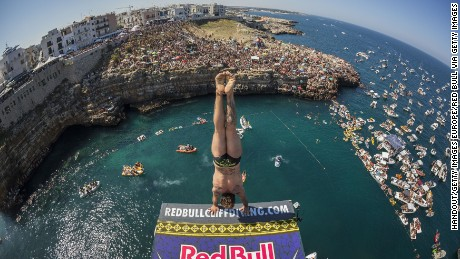 POLIGNANO A MARE, ITALY - AUGUST 28:  (EDITORIAL USE ONLY) In this handout image provided by Red Bull, Alessandro de Rose of Italy prepares to launch an armstand dive from the 27 metre platform during the fifth stop of the Red Bull Cliff Diving World Series, Polignano a Mare, Italy. (Photo by Romina Amato/Red Bull via Getty Images)