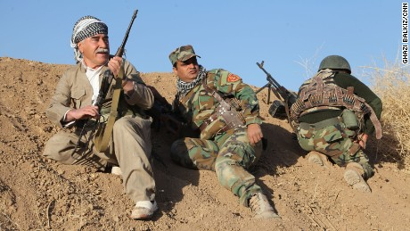 Kurdish fighters exchange fire with ISIS members in a village about 500 meters away on October 16, 2016.