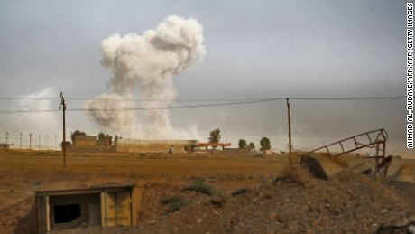 Smoke billows as Iraqi forces deploy on October 17, 2016 in the area of al-Shurah, some 45 kms south of Mosul, while advancing towards the city to retake it from the Islamic State (IS) group jihadists.Some 30,000 federal forces are leading the offensive, backed by air and ground support from a 60-nation US-led coalition, in what is expected to be a long and difficult assault on IS's last major Iraqi stronghold. / AFP / AHMAD AL-RUBAYE        (Photo credit should read AHMAD AL-RUBAYE/AFP/Getty Images)