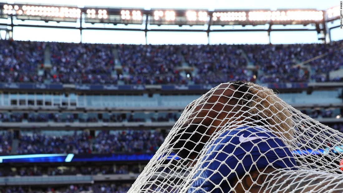 """New York Giants wide receiver Odell Beckham sticks his head through a sideline kicking net after scoring the go-ahead touchdown against Baltimore on Sunday, October 16. Beckham and the net have had <a href=""""http://nypost.com/2016/10/16/odell-beckham-takes-the-plunge-with-kicking-net/"""" target=""""_blank"""">an interesting relationship,</a> to say the least. Beckham attacked the net in anger three weeks ago, and then he hugged the net to """"make up"""" last week. This time around, he even got on one knee in a mock proposal."""