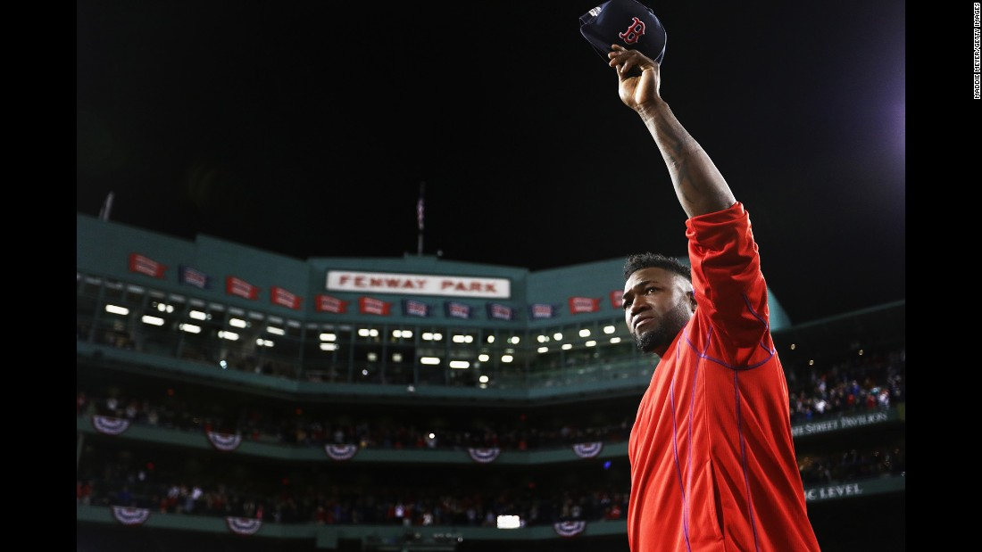 Retiring baseball star David Ortiz tips his cap to the home fans in Boston after playing his final game on Monday, October 10. Ortiz and the Red Sox were swept by Cleveland in the American League playoffs.