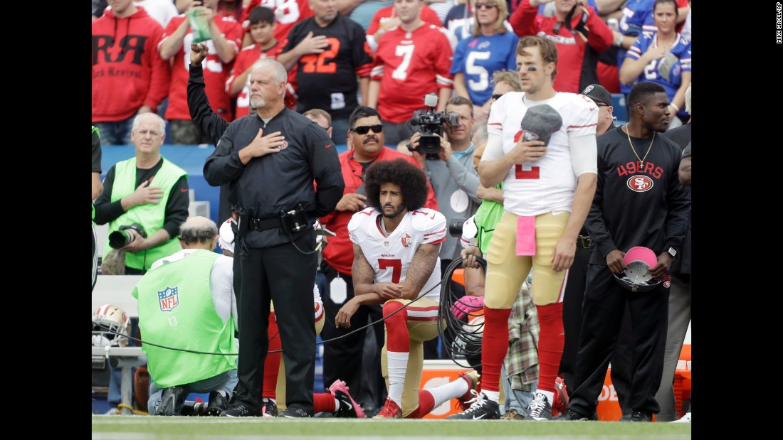 """San Francisco quarterback Colin Kaepernick kneels during the national anthem before an NFL game at Buffalo on Sunday, October 16. Kaepernick was <a href=""""http://www.cnn.com/2016/10/15/sport/colin-kaepernick-starts-anthem-protest/"""" target=""""_blank"""">starting his first game for the 49ers</a> since his protest began in August."""