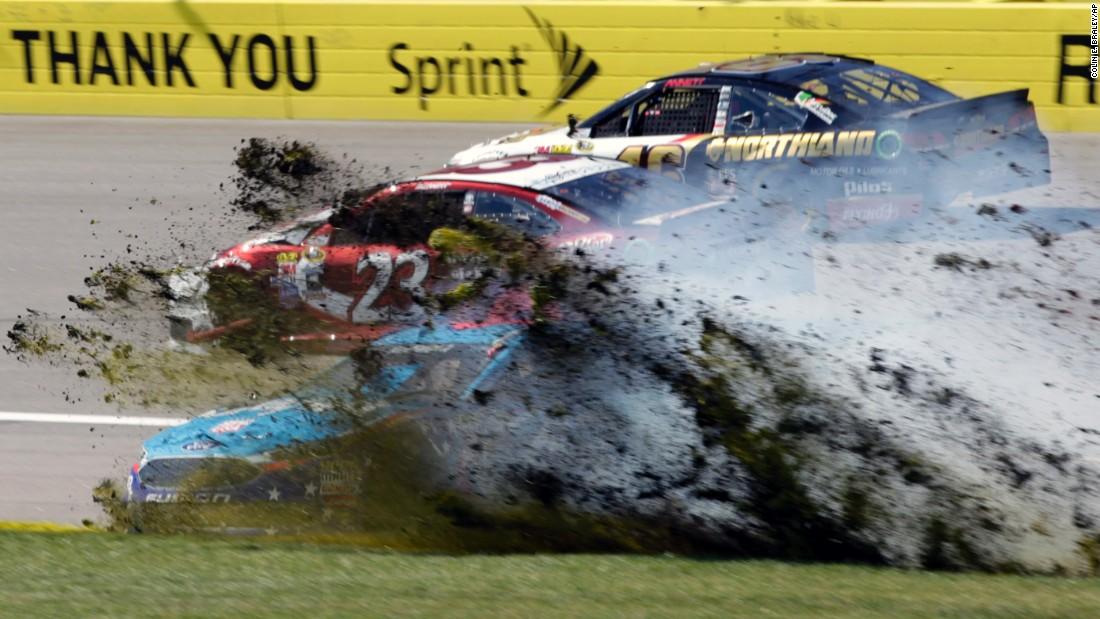 Aric Almirola's car plows through the infield at Kansas Speedway after colliding with David Ragan (No. 23) during a NASCAR Sprint Cup race on Sunday, October 16.