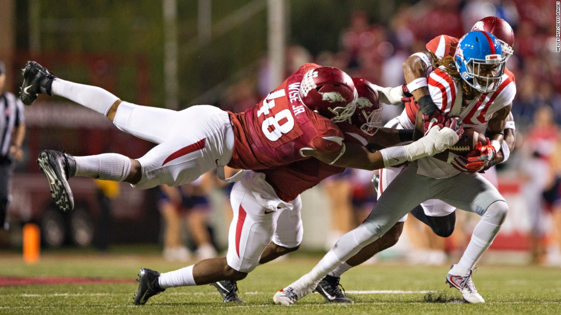 Ole Miss wide receiver Markell Pack is tackled by Arkansas defenders during a college football game in Fayetteville, Arkansas, on Saturday, October 15.
