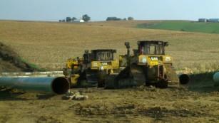 Pipeline project bulldozers burned