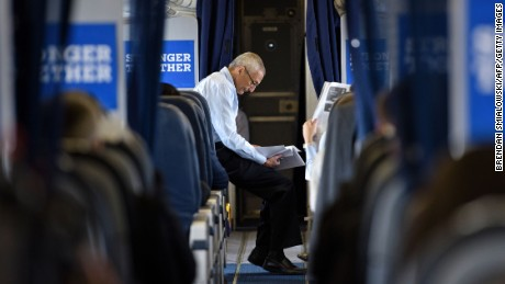 John Podesta, Clinton Campaign Chairman, reads over notes on board Democratic presidential nominee Hillary Clinton's plane at Westchester County Airport September 27, 2016 in White Plains, New York, before traveling with Clinton to Raleigh, North Carolina.