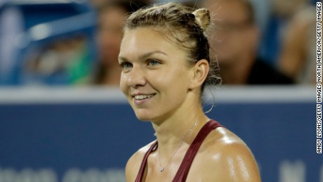 MASON, OH - AUGUST 19:  Simona Halep of Romania celebrates after winning her quarterfinal match against Agnieszka Radwanska during day 7 of the Western & Southern Open at the Lindner Family Tennis Center  on August 19, 2016 in Mason, Ohio.  (Photo by Andy Lyons/Getty Images)
