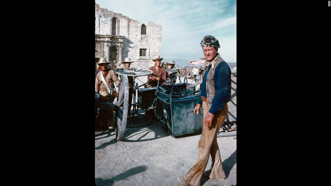 """John Wayne as Davy Crockett in the 1960 movie, """"The Alamo."""" How do Mexican-Americans see themselves reflected in such a movie when they have a different sense of history than many white Americans?"""