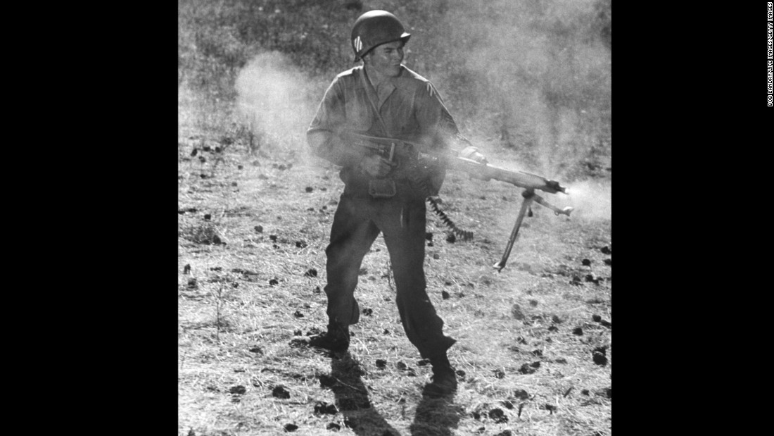 """Actor Audie Murphy, the most decorated soldier in World War II, performing in a scene from the movie """"To Hell and Back."""" White men with guns were the American heroes often taught in school."""