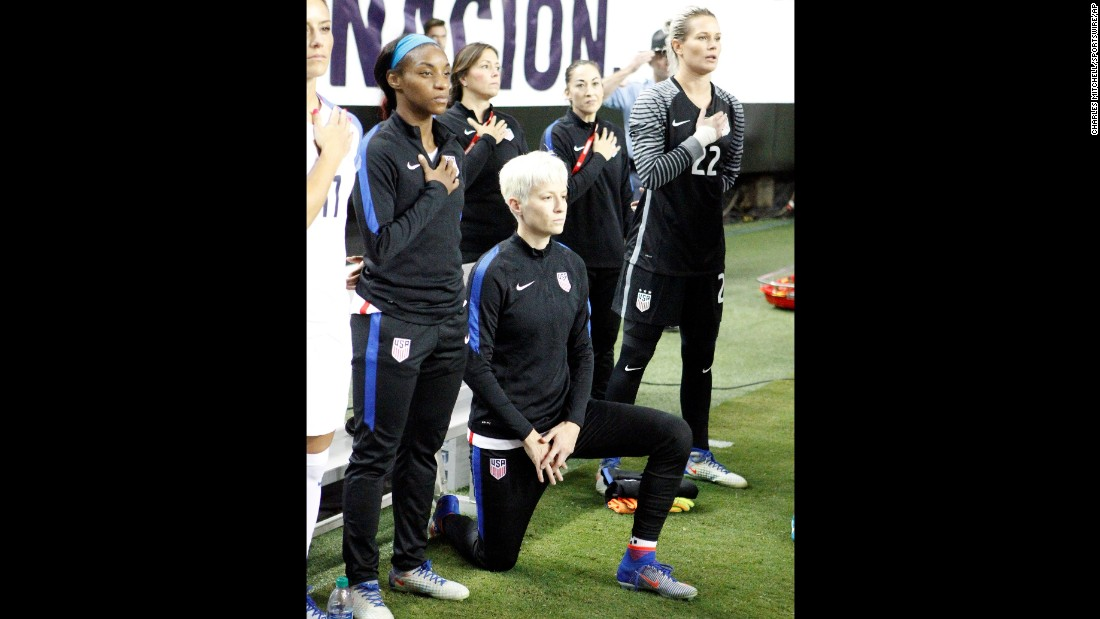 USA midfielder Megan Rapinoe kneels in protest while the national anthem is sung at a soccer match. Rapinoe said she knelt in part because she knows as a gay woman how it feels to not have her rights protected by her country.