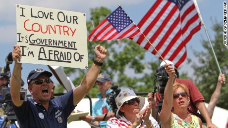 """The """"love it or leave it"""" attitude that has defined traditional patriotism has been seen at tea party rallies like this one in Philadelphia in 2010."""