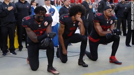 San Francisco 49ers outside linebacker Eli Harold, quarterback Colin Kaepernick and safety Eric Reid kneel during the national anthem before the team's NFL football game against the Arizona Cardinals in Santa Clara, California, Thursday, October 6.