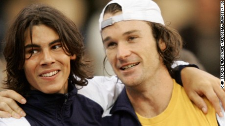 A teenage Nadal with Carlos Moya in 2004 after helping Spain win the Davis Cup title.