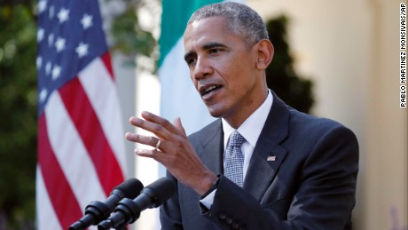 President Barack Obama answers a question during a joint news conference with Italian Prime Minister Matteo Renzi in the Rose Garden of the White House in Washington, Tuesday, October 18.