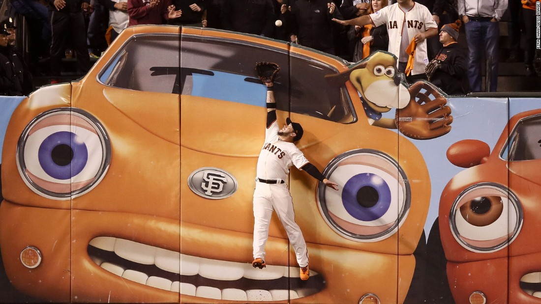 San Francisco outfielder Gregor Blanco can't prevent a Kris Bryant home run during Game 3 of the National League Division Series on Monday, October 10.