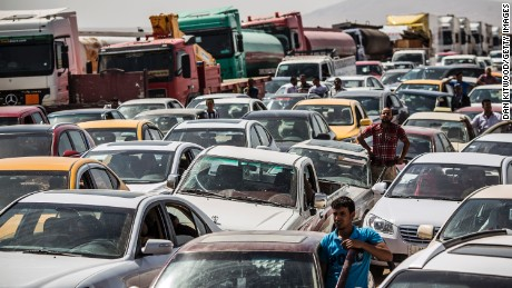 Traffic from Mosul queues at a Kurdish check point on June 14, 2014 in Kalak, Iraq.