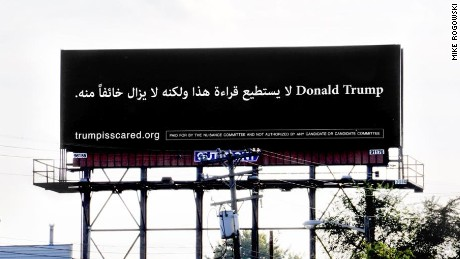 """A billboard in Dearborn, Michigan, reads """"Donald Trump can't read this, but he's afraid of it anyway"""" in Arabic."""