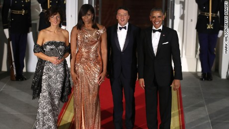 U.S. President Barack Obama (R) and first lady Michelle Obama (2nd L) stand with Italian Prime Minister Matteo Renzi and his wife Mrs. Agnese Landini upon arrival for a state dinner at the White House, October 18, 2016 in Washington, DC.