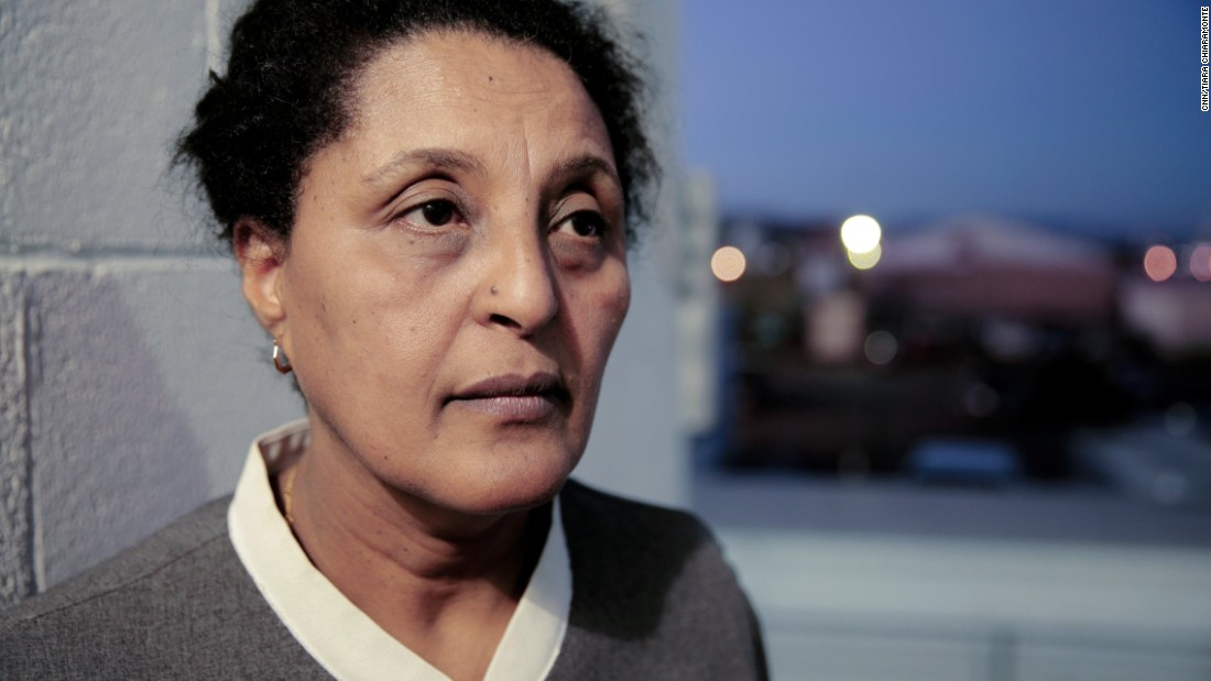 """Elizabeth Moges immigrated to the United States from Ethiopia five years ago. She works as a guest room assistant at the Trump International Hotel Las Vegas. """"America is an immigrant country, we don't need a wall,"""" she says. As a permanent resident she does not have a vote, but if she did she would vote for Hillary Clinton, she says."""