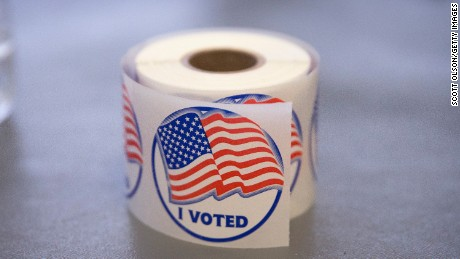 "A roll of ""I Voted"" stickers, which are handed out to residents after they vote, sit on an election officials table at a polling place on November 4, 2014 in Ferguson, Missouri.  In last Aprils election only 1,484 of Ferguson's 12,096 registered voters cast ballots. Community leaders are hoping for a much higher turnout for this election. Following riots sparked by the August 9 shooting death of Michael Brown by Darren Wilson, a Ferguson police officer, residents of this majority black community on the outskirts of St. Louis have been forced to re-examine race relations in the region and take a more active role in the region's politics. Two-thirds of Fergusons population is African American yet five of its six city council members are white, as is its mayor, six of seven school board members and 50 of its 53 police officers.  (Photo by Scott Olson/Getty Images)"