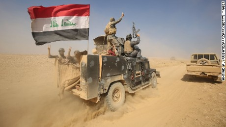 """TOPSHOT - Iraqi forces deploy in the Bajwaniyah village, about 30 kms south of Mosul, on October 18, 2016 after they liberated it from Islamic State (IS) group jihadists.     Tens of thousands of Iraqi forces were making gains on the Islamic State group in Mosul  in an offensive US President Barack Obama warned would be a """"difficult fight"""". / AFP / AHMAD AL-RUBAYE        (Photo credit should read AHMAD AL-RUBAYE/AFP/Getty Images)"""