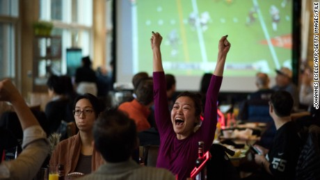 Fans cheer as they watch a live broadcast of Super Bowl XLIX between the New England Patriots and Seattle Seahawks, at a restaurant in Shanghai on February 2, 2015. A study released on January 28 by sports marketing research firm Repucom found that since 2013 interest in the NFL among the Chinese population has jumped from 1.7 percent to 7.9 percent.  AFP PHOTO / JOHANNES EISELE        (Photo credit should read JOHANNES EISELE/AFP/Getty Images)