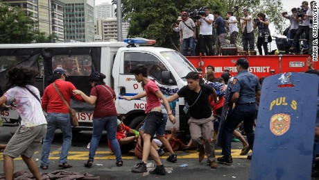 epa05591541 A police mobile runs over protesters during a protest in front of the US Embassy in Manila, Philippines, 19 October 2016. Hundreds of protesters including Indigenous People, students and militant groups stormed toward the US Embassy to protest against the presence of US military troops and to support Philippine President Rodrigo Duterte's independent foreign policy pronouncements. The protest ended violently as the protesters clashed with the police during the dispersal. Initial reports said at least five protesters and around thirty police officers were hurt.  EPA/MARK R. CRISTINO