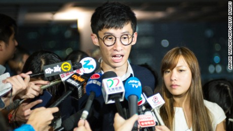 Sixtus Leung and Yau Wai-ching speak to the press after a court hearing Tuesday.