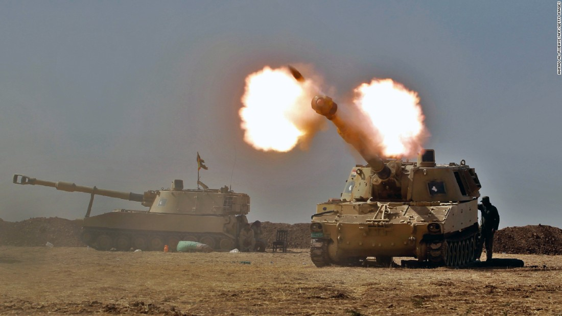 Iraqi forces fire a howitzer toward the village of Tall al-Tibah on October 19.