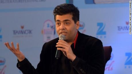 Indian Bollywood director Karan Johar speaks during the 'Unsuitable Boy' event moderated by Shobhaa De (C) during the Jaipur Literature Festival in Jaipur on January 21, 2016. AFP PHOTO / STR / AFP / STRDEL        (Photo credit should read STRDEL/AFP/Getty Images)