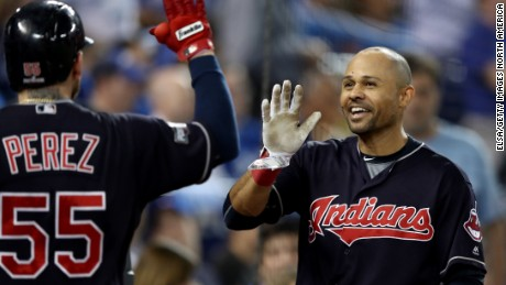 TORONTO, ON - OCTOBER 19:  Coco Crisp #4 of the Cleveland Indians celebrates with Roberto Perez #55 after hitting a solo home run in the fourth inning against Marco Estrada #25 of the Toronto Blue Jays during game five of the American League Championship Series at Rogers Centre on October 19, 2016 in Toronto, Canada.  (Photo by Elsa/Getty Images)