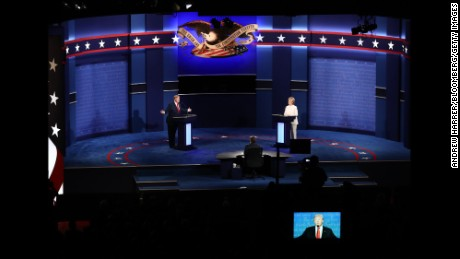 Donald Trump, 2016 Republican presidential nominee, speaks as Hillary Clinton, 2016 Democratic presidential nominee, listens during the third U.S. presidential debate in Las Vegas, Nevada, U.S., on Wednesday, Oct. 19, 2016. Donald Trump is trying another wild-card play in the third and final presidential debate with Hillary Clinton in perhaps his last chance to reverse his campaign's spiral and halt his Democratic rival's rising electoral strength. Photographer: Andrew Harrer/Bloomberg via Getty Images