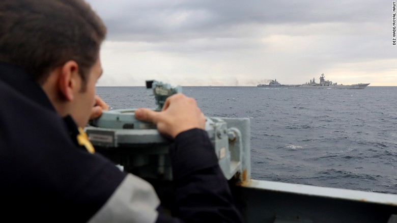 A Royal Navy lookout observes a Russian military fleet as it travels toward the English Channel.