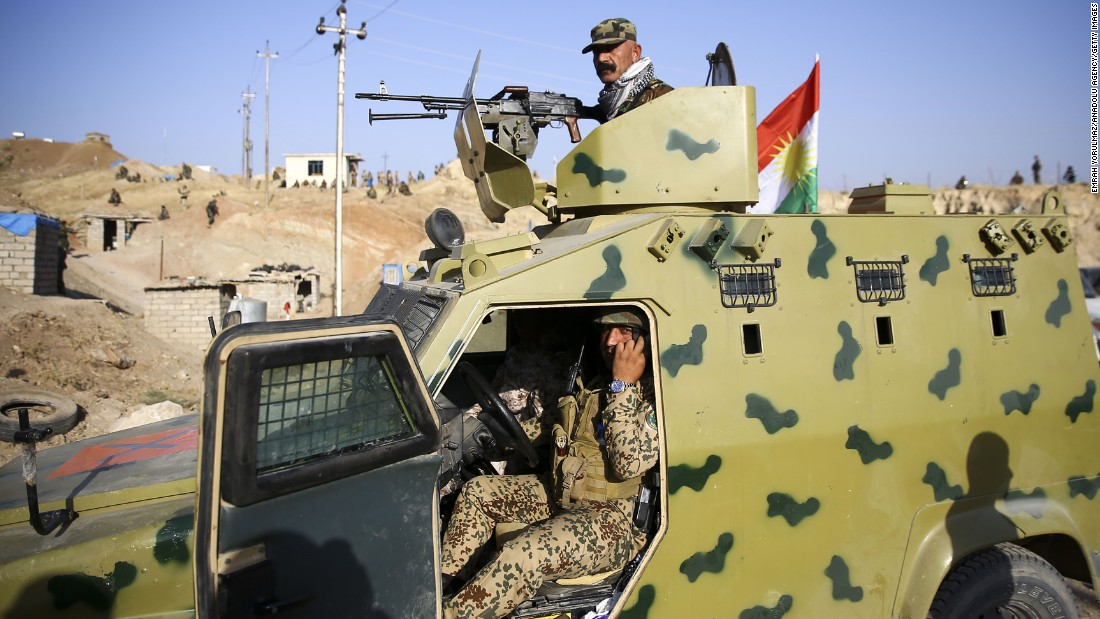 Peshmerga forces move on ISIS targets near the village of Naveran on October 20.