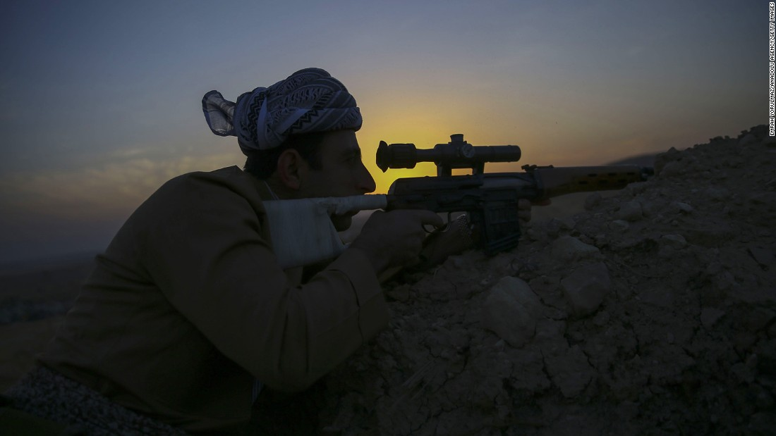 A Peshmerga fighter takes aim near Naveran on October 20.