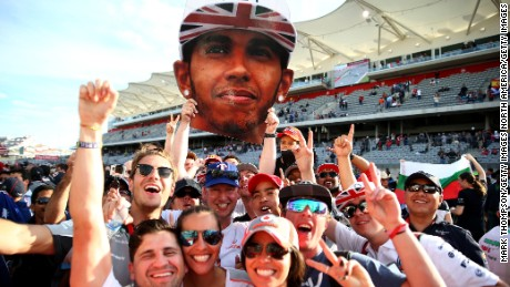 AUSTIN, TX - NOVEMBER 02:  Fans of Lewis Hamilton of Great Britain and Mercedes GP celebrate his victory after the United States Formula One Grand Prix at Circuit of The Americas on November 2, 2014 in Austin, United States.  (Photo by Mark Thompson/Getty Images)