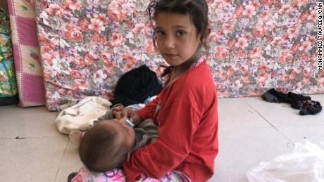 An Iraqi girl and baby at Debaka Camp, near Irbil.