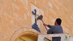 Pain still raw for Mosul's Christians in Jordan