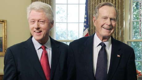Washington, UNITED STATES:  Former US Presidents George H.W. Bush(R) and Bill Clinton smile as they leave the Oval Office 01 September, 2005 at the White House in Washington, DC. The two former presidents were tapped by US President George W. Bush to lead a private fund-raising campaign for victims as they did for last year's Asian tsunami.