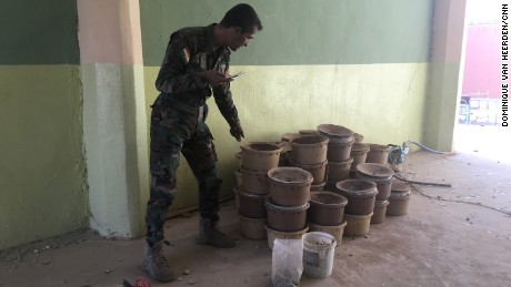 Captain Chilhan Sadk shows CNN containers full of potassium nitrate that Isis left behind as a booby trap