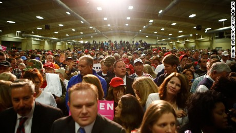 Supporters of Republican presidential candidate Donald Trump wait for his arrival at a rally on October 21, 2016 at the Western North Carolina Agricultural Center in Fletcher, North Carolina.