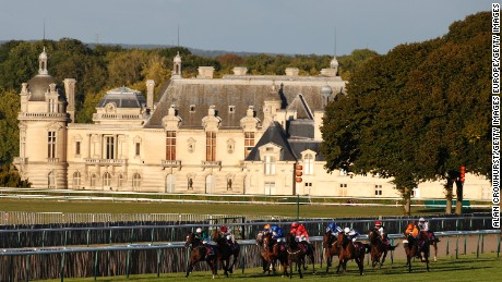 CHANTILLY, FRANCE - OCTOBER 02: Harry Bentley riding Limato (L, green) win The Qatar Prix de La Foret at Chantilly racecourse on October 02, 2016 in Chantilly, France. (Photo by Alan Crowhurst/Getty Images)