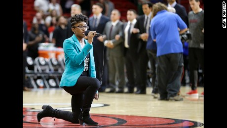 Denasia Lawrence sings the national anthem before an NBA preseason basketball game between the Miami Heat and the Philadelphia 76ers, October 21, in Miami.