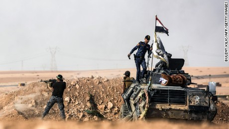 Members of Iraqi pro-government forces hold a position on the frontline on October 21, near the village of Tall al-Tibah, some 30 kilometres south of Mosul, during an operation to retake the main hub city from the ISIS.