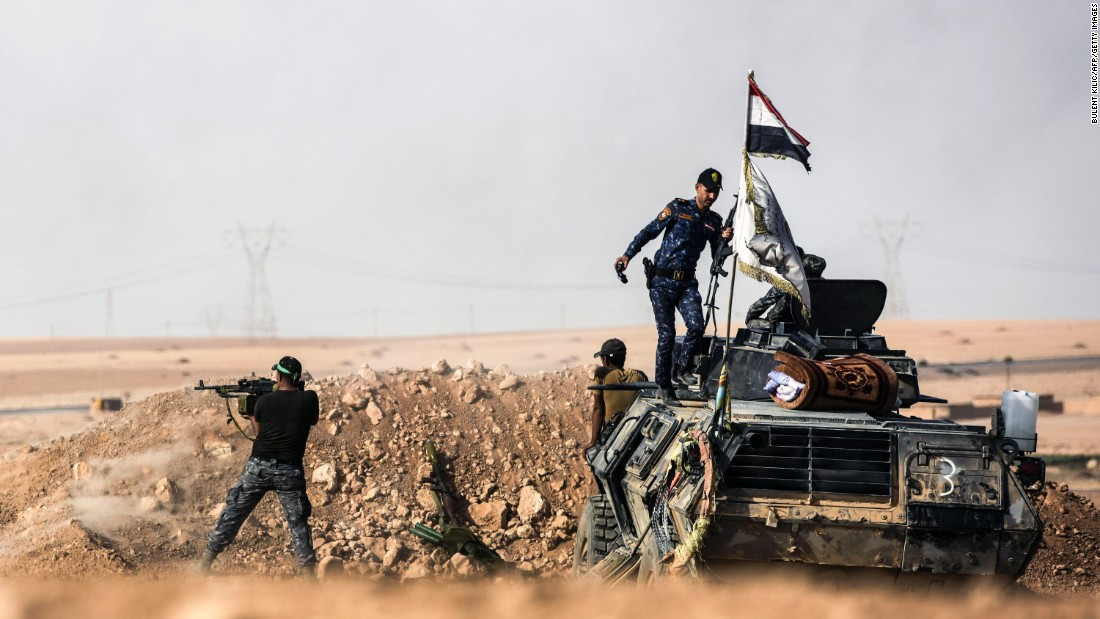 Iraqi forces hold a position on the front line, near the village of Tall al-Tibah, on Friday, October 21.