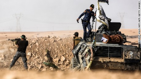 TOPSHOT - Members of Iraqi pro-government forces hold a position on the frontline on October 21, 2016 near the village of Tall al-Tibah, some 30 kilometres south of Mosul, during an operation to retake the main hub city from the Islamic State (IS) group jihadists.  The operation is Iraq's biggest in years and aims to wrest back Mosul, the country's second city and the last major IS stronghold in Iraq. / AFP / BULENT KILIC        (Photo credit should read BULENT KILIC/AFP/Getty Images)