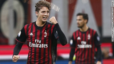 AC Milan's midfielder Manuel Locatelli celebrates after scoring (L) during the Italian Serie A football match AC Milan versus Juventus on October 22, 2016 at the San Siro Stadium in Milan.  / AFP / MARCO BERTORELLO        (Photo credit should read MARCO BERTORELLO/AFP/Getty Images)