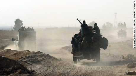 """Shiite fighters from the Popular Mobilization Forces arrive in an area south of Mosul, on October 22, 2016, during an operation to retake the main hub city from the Islamic State (IS) group jihadists. Mosul is the most populous city in the """"caliphate"""" Baghdadi declared in June 2014, and the operation to recapture it is Iraq's largest in years.  / AFP / AHMAD AL-RUBAYE        (Photo credit should read AHMAD AL-RUBAYE/AFP/Getty Images)"""