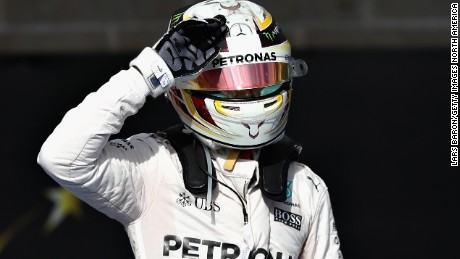 Lewis Hamilton celebrates his win in parc ferme after a commanding performance in the US GP in Texas.